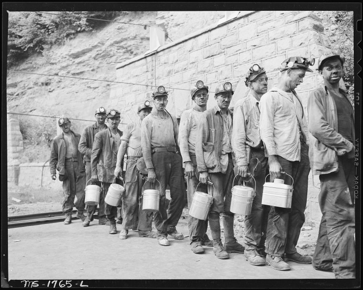2402px-Miners_checking_in_at_the_lamp_house_at_completion_of_morning_shift._Koppers_Coal_Division,_Kopperston_Mines..._-_NARA_-_540922